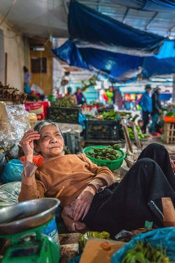 I plan to retake this picture (but better) because I didn't like how I composed this shot. I've walked through the local market everyday now. And I swear this old lady 👵 hasn't moved an inch. That is why I am posting this pic anyway. I want us to find out, when I eventually go back if she is in the same spot, wearing the same clothes, and doing the same thing (nothing) 🤣 Real People Market Outdoors Food Women Food And Drink Selling For Sale Large Group Of Objects Variation Market Stall One Person Day Men Freshness Adults Only People Adult Vietnamese Market Women Around The World The Street Photographer - 2017 EyeEm Awards The Photojournalist - 2017 EyeEm Awards Place Of Heart