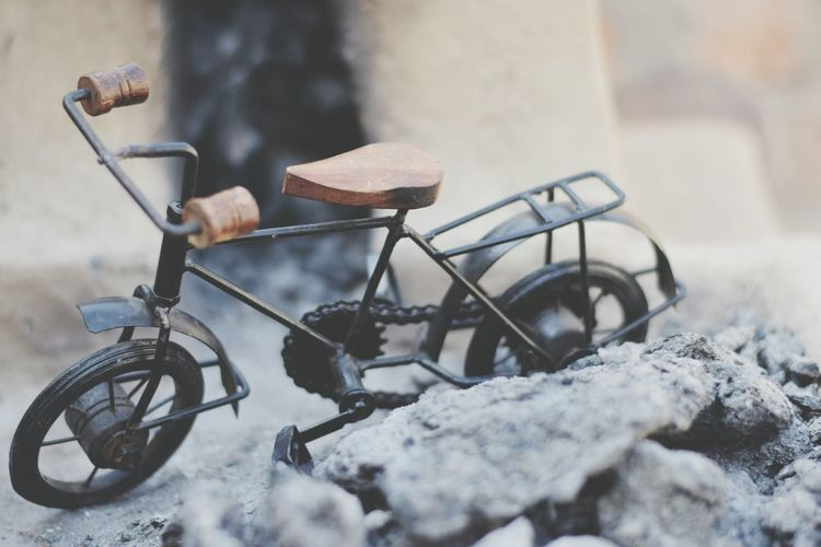 Close-Up Of Model Bicycle By Stones