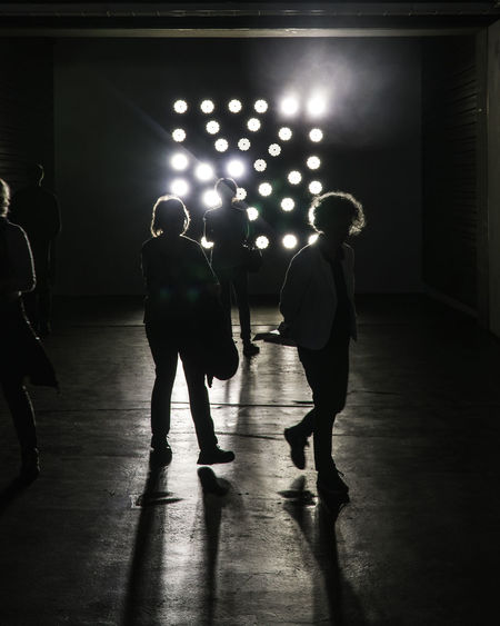 People Walking In Darkroom