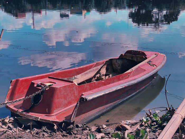 Broken boat Water Mode Of Transportation Nautical Vessel Transportation Reflection Lake Nature Abandoned High Angle View No People Beach Land Red Fishing Boat Obsolete Moored Day Old Outdoors Inflatable