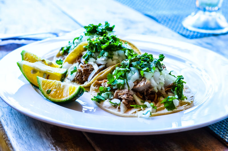 High angle view of tacos in plate on table