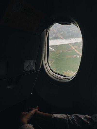 Person seen through airplane window