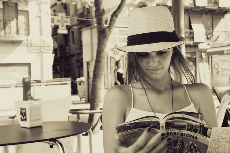 Barcelona Blackandwhite Chair City Life Focus On Foreground People And Places Pretty Reading Sidewalk Cafe Sitting Table Tourist Young Adult