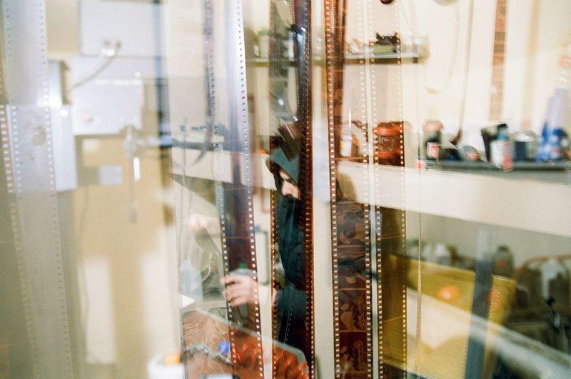 Man seen through film reels