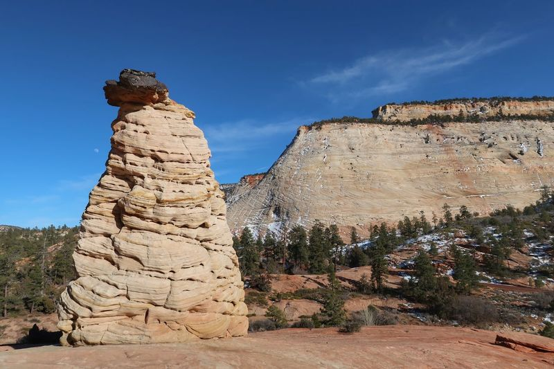 White rock formation and hill at Checkerboard Mesa Zion National Park Rock Formation Rock - Object Geology History Sky No People Day Mountain Rock Hoodoo Nature Beauty In Nature Physical Geography Travel Destinations Outdoors Go Higher