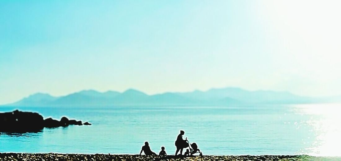 Warm sunny day Nature Beach Summer Lifestyles Family Love Landscape Silhouette Blue Sea Sky Water Tranquility Outdoors Day Scenics Clear Sky Togetherness Beach Adult People Nature Nautical Vessel Beauty In Nature