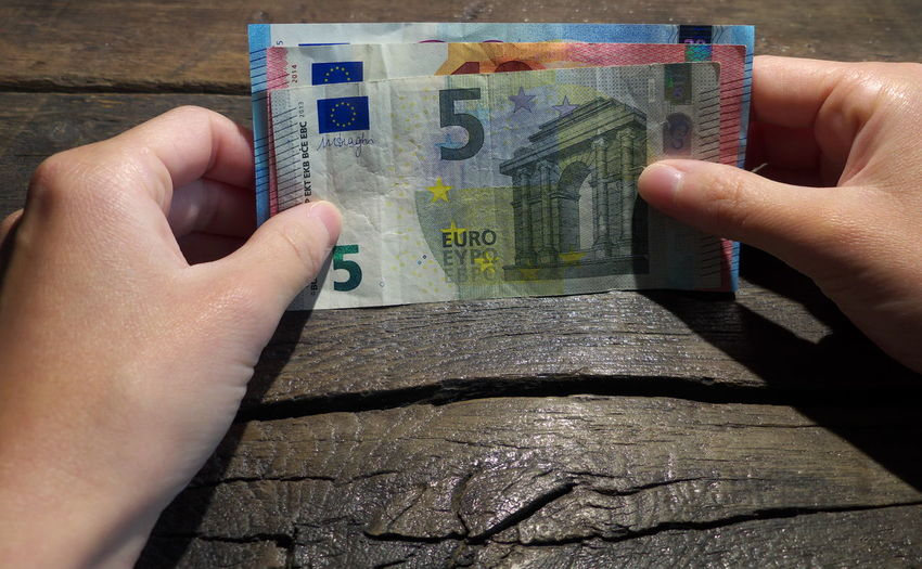 Paper currency Close-up Currency Day Euros Finance Geldscheine Holding Human Body Part Human Finger Human Hand Lifestyles One Person Paper Currency People Real People Wealth