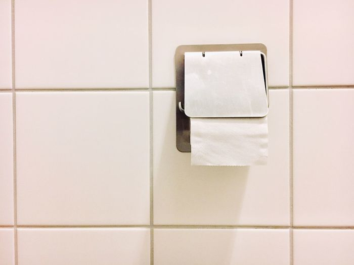 Close-up of toilet roll in bathroom