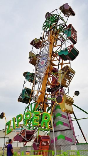Amusement Park Amusement Park Ride Arts Culture And Entertainment Low Angle View No People Outdoors Day Ferris Wheel Sky Carousel Rides Rides At Fair