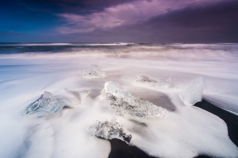 The Diamond Beach in East Iceland. Iceland Jökulsárlón Beach Beauty In Nature Cloud - Sky Cold Temperature Day Frozen Horizon Over Water Ice Iceberg Idyllic Long Exposure Motion Nature No People Outdoors Scenics Sea Sky Snow Tranquil Scene Tranquility Water Wave