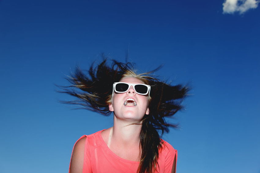 Blue Clear Sky Front View Girl Happiness Headshot Jumping Long Hair Looking At Camera Low Angle View Person Portrait Young Adult Young Women Blue Wave Let Your Hair Down Fresh On Market May 2016 Fresh On Market 2016
