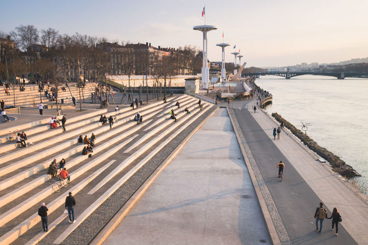 High angle view of people on quayside against sky