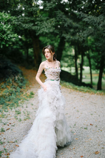 Calvin Klein Chanel Dior Fashion Milano Monza Wedding Adult Beautiful Woman Beauty Bride Celebration Fashion Favorite Full Length Looking At Camera Newlywed Outdoors Plant Portrait Real People Tree Wedding Wedding Dress Women