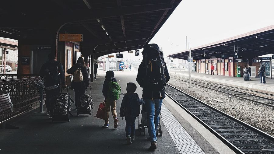 The fact that parents let their kids to tag along when travelling is somewhat an eye-opening to the kid's next journey- being an adult. Parents Happyfamily Gare Babystroller Kids Backpacking This Is Family Full Length Men Railroad Station Platform Child Railroad Station Public Transportation Train