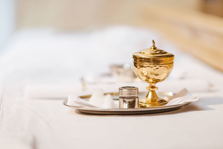Church Baptism Beliefs And Religions Belief Religious  Religion Tray Setting Silver Colored Crockery Absence Plate Success Focus On Foreground Still Life Metal Close-up Copy Space No People Table Gold Colored Indoors  Chrism Chrisam
