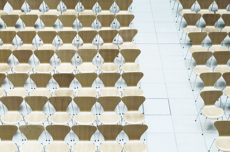 High angle view of empty chairs arranged indoors