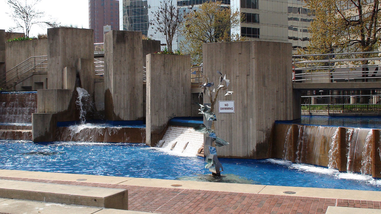 water, architecture, built structure, building exterior, outdoors, day, motion, swimming pool, tree, no people, city, nature