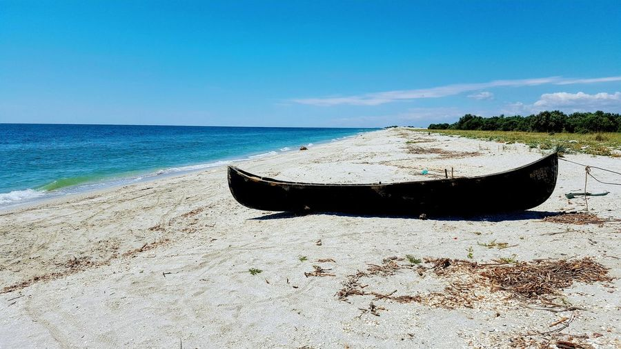 lonelyness Water Nautical Vessel Sea Beach Sand Clear Sky Sky Horizon Over Water Shore Sandy Beach Wave Boat Water Vehicle Tide Calm