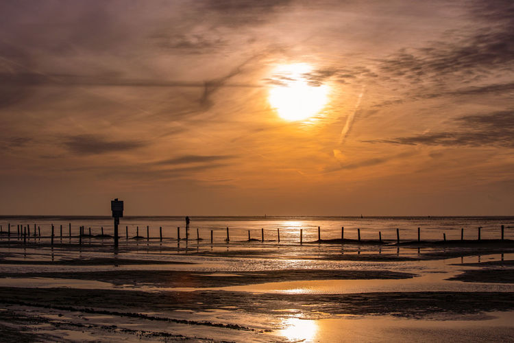 Nordsee Water Sunset Sky Sea Beauty In Nature Beach Cloud - Sky Land Orange Color Scenics - Nature Reflection Horizon Over Water Sunlight Sun Idyllic Outdoors Horizon Nature Flood Sankt Peter-Ording Tranquility Tranquil Scene