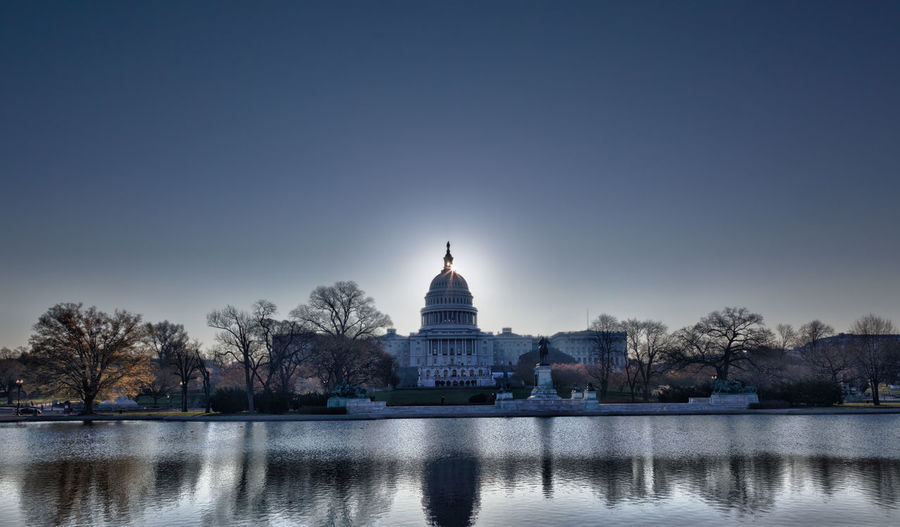 Sunrise at the US Capitol building in the capital city of Washington DC in the USA Capitol DC Government Reflection Skyline US Capitol US Capitol Building USA Washington Washington DC Washington, D. C. Capital Clear Sky Congress Dawn Dome Government Lake Pool Rising Sun Sun Sunrise