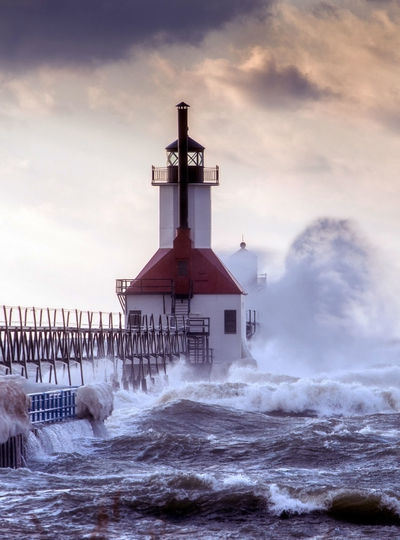 waves crash against the St Joseph lighhouse, on a windy, cold d february day, on the shores of Lake Michigan Wave Power In Nature Built Structure Stormy Weeather Architecture St Joseph Lighthouse Lighhouse Landmark Lake Michigan Landscape Michigan USA North America Great Lakes Motion Waves Water High Waves Cold Temperature Winter Windy Day February Outdoors Nature Beauty In Nature Sky The Great Outdoors - 2019 EyeEm Awards The Architect - 2019 EyeEm Awards