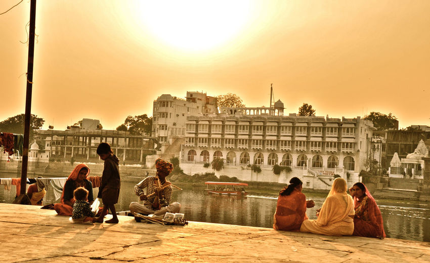 India Indian Family Lifestyles Sitting Sunset Tourism Travel Destinations Udaipur