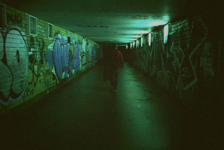 Man walking in subway tunnel