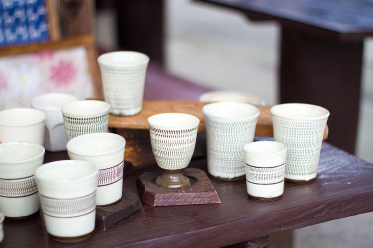 Tea Cups On Wooden Table For Sale At Market