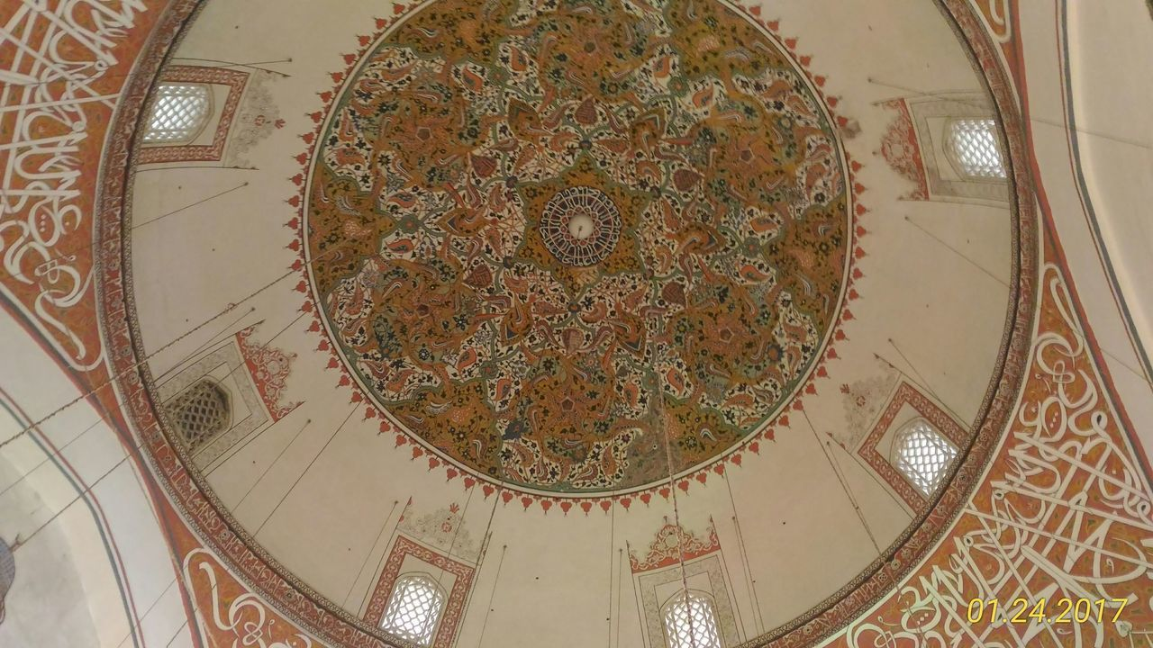 low angle view, design, indoors, ceiling, architecture, spirituality, religion, place of worship, built structure, no people, pattern, architectural design, day, close-up