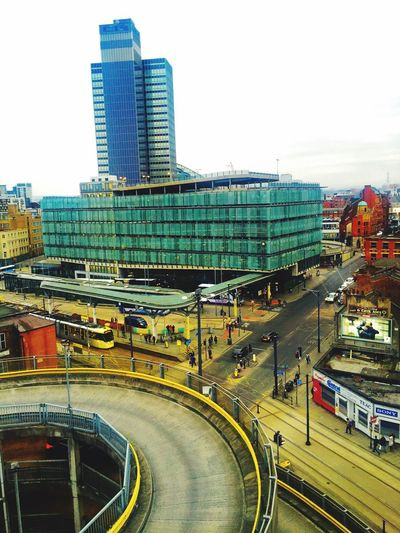 Aerial View Of Manchester Cityscape From Above Everyday Lives Traffic Life In Motion Buildings Town View From Above Urban Architecture Roads Street Busy City Life Cityscapes Aerial Shot Public Transportation Tram People Shudehill Bus Station