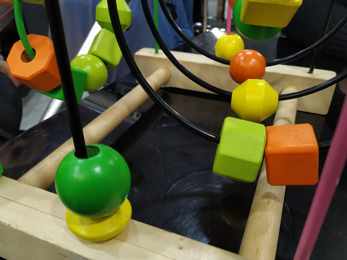 Multicolor baby toy Multi Colored Indoors  No People Yellow Close-up Table Green Color Choice Variation Still Life Toy Connection High Angle View Large Group Of Objects Baby