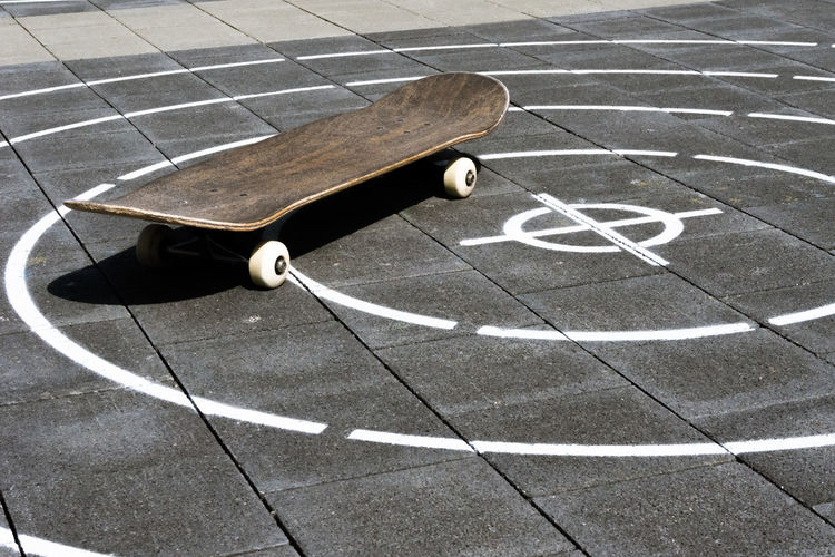 High angle view of skateboard on footpath