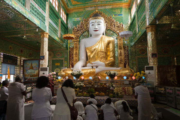 Buddha Statue and Worshipers at Soon U Ponya Shin Pagoda, Sagaing, Mandalay, Myanmar. Attraction Buddha Burma Devotee Gold Myanmar Peace Religion Sculpture South East Asia Statue Temple Tourist Wanderlust
