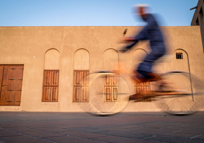 Chilax just ride! Arab Architecture Bicycle Bike Blurred Motion Bur Dubai Cycling Day Dubai Emirates Leisure Activity Men Motion Muslim One Person Outdoors Real People Rider Riding Speed Street Street Photography Streetphotography The Street Photographer - 2017 EyeEm Awards Transportation
