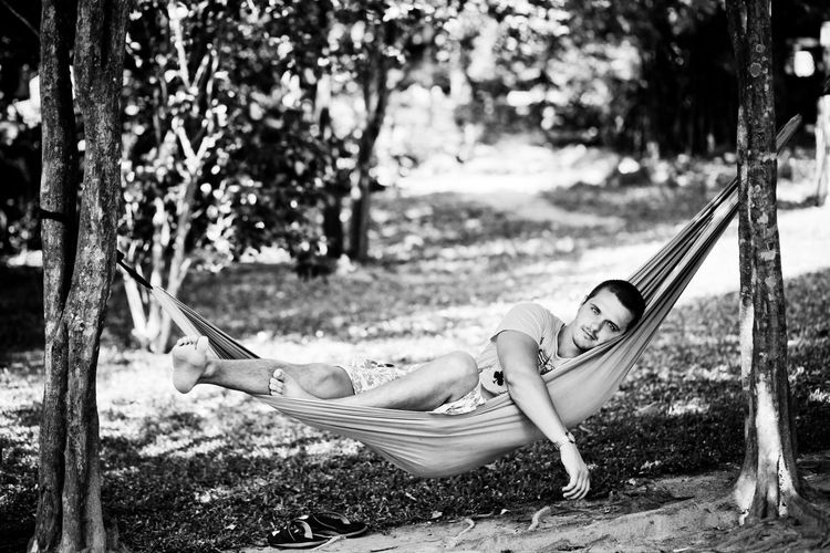 Portrait of man lying in hammock