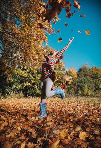 Autumn Colour Fuji Xt10 Tree Autumn One Person Fujifilm_xseries Lifestyles Outdoors Real People Orange Color Leaves Autumn Colors Autumn Leaves Autumn Authentic Moments Autumn🍁🍁🍁 Leisure Activity Low Angle View Motion Leaf Adventure Nature Jumping Beauty In Nature Sky Young Women