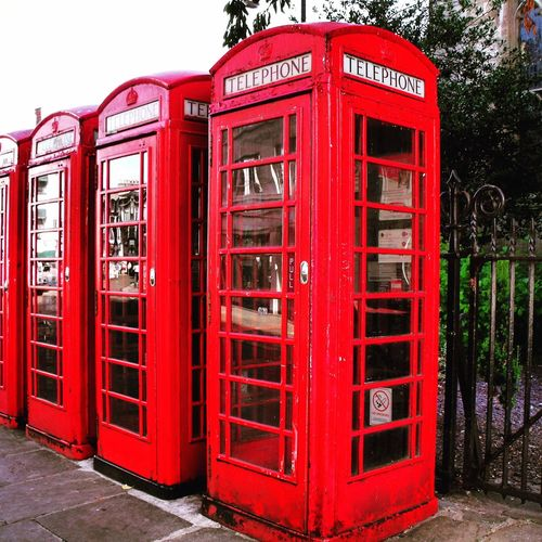 Telephone boxes Red Telephone Booth Communication Pay Phone Telephone Text Day Outdoors No People Tree Sky Phone Box Red English Phone Box Three In A Row Payphones Of The World Payphonesstillexist The Street Photographer - 2017 EyeEm Awards EyeEmNewHere