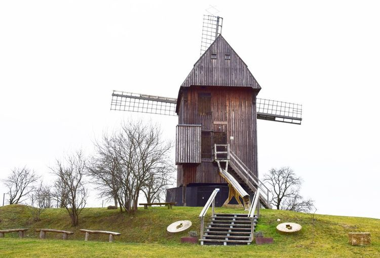 Mühle in Vehlefanz Sky Built Structure Architecture Building Exterior Clear Sky No People Tree Building Nature Day Wood - Material Plant Bare Tree Grass Landscape Field Land Outdoors Rural Scene Mill Historical Building Agriculture Old Technology Hill Village