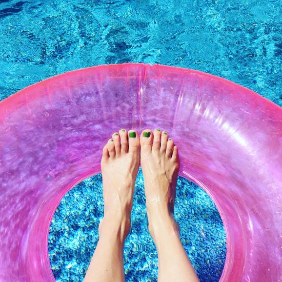 Inflatable ring with feet in a swimming pool Floaty Relaxing Summer Water Swimming Summertime Happiness Swim Swimming Pool Barefoot Relaxed One Person Summer Views Leisure Activity Personal Perspective Inflatable Ring Pool