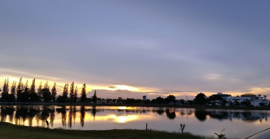 Unisel lakeside sunset Auto Post Production Filter Bare Tree Beauty In Nature Blue Cloud Cloud - Sky Cloudy Distant Dusk Horizontal Symmetry Human Settlement Lake Lake View Majestic Nature No People Outdoors Overcast Sky Sunset Symmetry Taken On Mobile Device Tranquil Scene Traveling Unisel