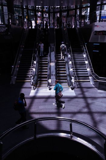 High angle view of people walking on staircase in city