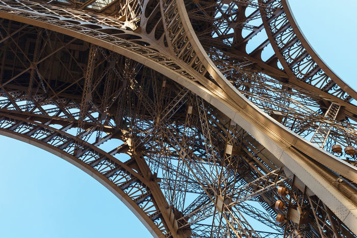 Eiffel Tower in Paris, bottom view against clear blue sky Architecture Blue Sky Built Structure Capital City Eiffel Tower Famous Place Famous Places Low Angle View Metalwork No People Outdoors Sky Steel Steel Structure  Tourism Tourist Attraction  Tower Travel Destinations Unusual Visit