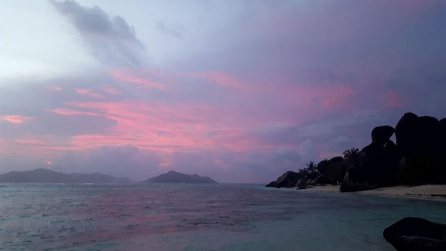 Landscape Mountain Sunset Cloud - Sky Nature Outdoors Sea Sky No People Scenics Beauty In Nature Water Beach Day Anse Source D'argent Travel Horizon Over Water Seychellesisland La Digue Tropical Paradise Seychelles Sunset Nature Beauty In Nature Dramatic Sky Summer