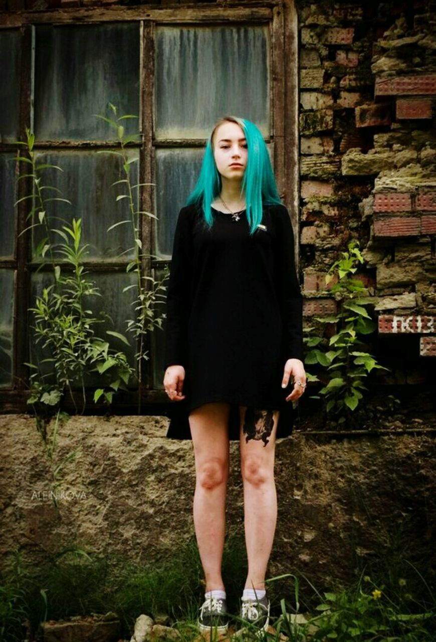 front view, one person, young adult, fashion, standing, real people, beautiful woman, portrait, full length, looking at camera, young women, lifestyles, outdoors, dyed hair, day, adult, people, adults only