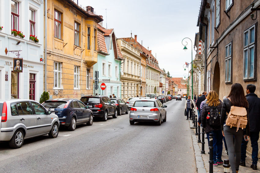 Brasov, Romania, October 06, 2017 : The Gateway Schei Street (Strada Poarta Schei) in the Brasov city in Romania City Gateway Schei Street Place Poarta Schei Romania Shay Gate Strada Poarta Schei Transylvania Travel Architecture Brasov Building Exterior Built Structure City Day Europe Famous Place Heritage Historic Old Outdoors Street Three Arches Tourism Urban