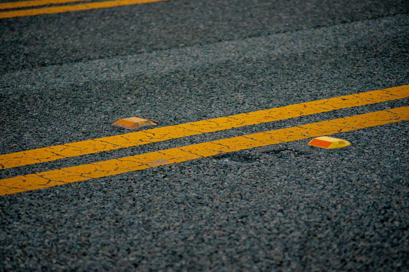 High angle view of double yellow lines on road