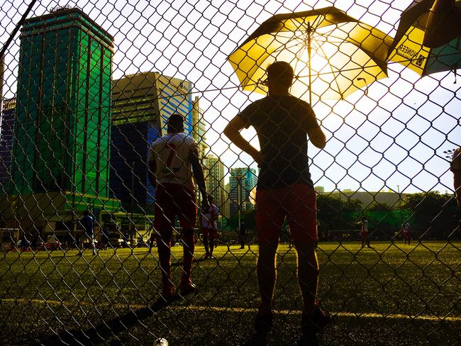 Man with Umbrella Sport Sports Team Only Men Competition Standing Real People Playing Field People Sports Clothing Sports Photography Eyeem Philippines