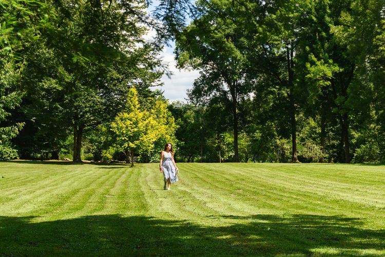 Woman walking in park, green, spring.