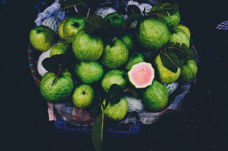 High angle view of guavas on basket for sale in market