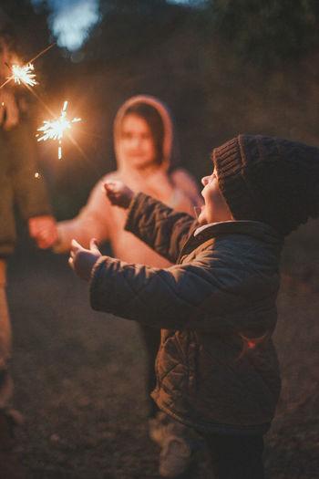 Children celebrating with illuminated sparkler